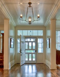 Love the extra wide front door, the screen door, sidelights, and light fixtures.  - Historical Concepts