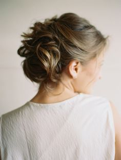 The perfect messy updo: http://www.stylemepretty.com/washington-weddings/seattle/2015/12/29/stylish-modern-winter-wedding-inspiration/ | Photography: Anna Peters - http://www.annapetersphoto.com/