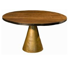 Since the table of my dreams will probably have to stay that way, the Cone table from Organic Modernism might someday be an affordable substitute.