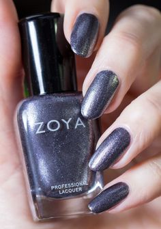 "Zoya Troy is described as a ""liquid pewter with a foil finish and an edgy touch of black and gold"""