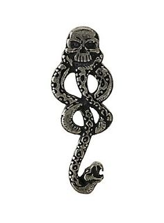 "Wish you were a part of Voldemort's inner circle? Yeah, us too. Brand yourself with the Dark Mark to let everyone know you're with Voldemort by wearing this pin from Harry Potter.<br><br><ul><li style=""LIST-STYLE-POSITION: outside !important; LIST-STYLE-TYPE: disc !important"">1/2"" x 1 1/2""</li><li style=""LIST-STYLE-POSITION: outside !important; LIST-STYLE-TYPE: disc !important"">Imported</li></ul>"