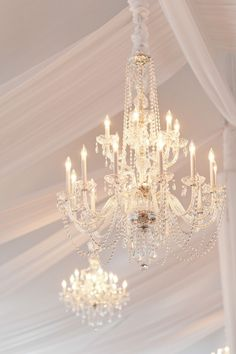 Beautiful tent chandeliers | Photography: Leila Brewster - leilabrewsterphotography.com Read More: http://www.stylemepretty.com/new-england-weddings/2014/04/28/old-hollywood-glamour-ocean-house-wedding/