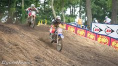 Yamalube Star Racing Yamahas Jeremy Martin leads GEICO Hondas Justin Bogle down a hill on the backside of the track in the first 250 moto.