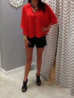 Great outfit!  Red cape, french connection linen shorts and some stunning gold jewelry.