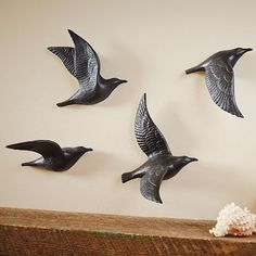 Add dimension and captivating visual energy, unlike any other form of wall d, with our bone china Flying Gulls Wall Art.             A sculptural step beyond ordinary paintings and prints                Our Flying Gulls Wall Art is a complete study of flight, with each figure representing one stage of motion                Features a rich matte black finish                Each figure incorporates a nail hole for easy hanging