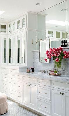 Looks like a spa with all the Carrara marble!   Via TraditionalHome.com