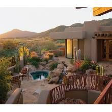 The landscape designer dealt with grade changes by creating a multilevel terrace in the back yard. She planted desert grasses, euphorbias, octopus agaves and such cacti as blue cardon, Mexican fencepost and golden barrel.