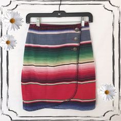 Vintage Mexican blanket skirt hobo hippie gypsy One of a kind southwest Mexican blanket wrap skirt! Made from the same material as the authentic Mexican blanket. Great for Lowrider car shows, Mexican holidays, day of the dead festival, and many more.. Detailed black stitching, and 3 silver flower design buttons. Slightly used but in perfect condition. When laid flat the measurements are: length 19, waist 12 1/2 inches. F.l. Malik Skirts Asymmetrical