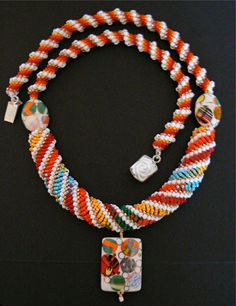Cellini and Dutch spiral necklace, ceramic art glass focal beads, sterling silver clasp.
