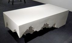 White marble coffee tables as design elements for high end living room interior design. Marble is durable and features unique textures and color.