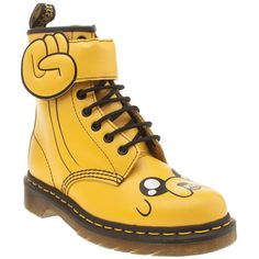 Jake the dog morphs into his best shape to date, as the Adventure Time Jake Boot from Dr Martens arrives. The vibrant yellow leather upper features contrasting prints of Jake's face across the toe, whilst a fist pump touch fastening strap finishes.