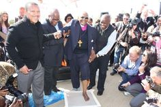 Archbishop Emeritus Desmond Tutu leaves his footprint, as part of the Footprints Project at Maropeng on July 31