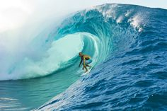 Surfing big waves like this fascinates me - I can't do it but wow!