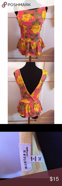 Peplum floral top Very cute and flattering top! I have only worn this twice and was extremely comfortable and fun! Add a bit of color to your outfit!                     Make an offer! Tops Tank Tops