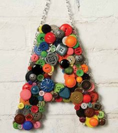 "Super cute hanging button letter | Use a a monogram front door ""wreath"" --- Find #DIY Directions at Joann.com"