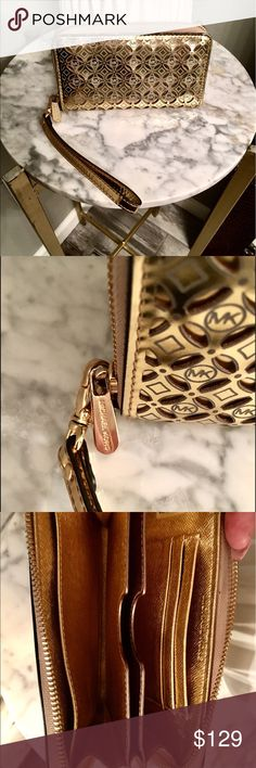 Gold Michael Kors Wallet or Wristlet This can be used as a Wallet or Wristlet. In excellent condition, has only been used a couple of times.  The matching tote is also available in my closet. MICHAEL Michael Kors Bags Clutches & Wristlets