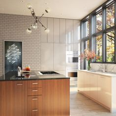 dark grout white subway tile + chalkboard panel + modern cabinets + marble detail in kitchen by incorporated