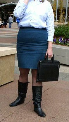 """A woman with all the elements that produce the best wrinkles on the front of a skirt: wide hips/thick thighs, a """"bulging belly"""", and a tight skirt. Pressure on the fabric in the crotch area from bending/sitting created the intense horizontal wrinkles on her skirt crotch. Less than 1% of women's skirts are this wrinkled, most wear looser skirts and think this looks bad. I love the way it looks, a sexy worn look!"""