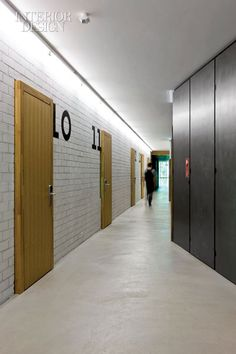 Hostel in Basel, Switzerland Hotel Hallway, Hotel Corridor, Door Signage, Corridor Lighting, Apartment Entrance, Student House, Lobby Design, Hotel Interiors, Dormitory
