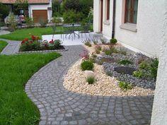 Vorgartengestaltung mit Kies - Mit Kiesel- und Natursteinen kann man einen effektvollen, originellen und zugleich pflegeleichten Vorgarten gestalten...
