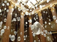 that'd be sooooo easy!!!! and its so pretty!!! we could run wires between the curtain walls and use thread to hang different size translucent balloons it would look like beautiful bubbles.