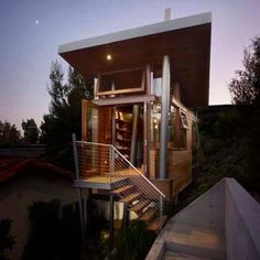 This grown-up tree house in Los Angeles was created by Rockefeller Partners Architects in 2009, and is now home to an art studio. The modern structure, which is stands twelve feet above the ground, is made of steel and features a cedar-paneled exterior.   Photo: Courtesy Eric Staudenmaier | thisoldhouse.com