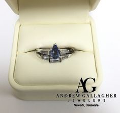 (11/18/15) 50% OFF! 14K White Gold Tanzanite and Diamond Wedding Set!   The Engagement Ring has a pear shaped tanzanite set in the center with a one baguette on each side of the center stone. The wedding band has three (3) baguettes| Original Retail Price: $4500.00 SALE PRICE: $2500.00. | I Call Andrew Gallagher Jewelers at 302-368-3380 for more information. We SHIP!! | #50OffJewelryCase