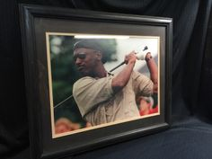 THIS IS BELIEVED TO BE MICHAEL JORDAN PLAYING GOLF THAT IS NICELY FRAMED AND MATTED. MEASURES 18 X 22.