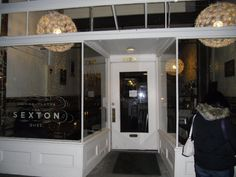The Sexton, 5327 Ballard Avenue NW, (BALLARD), Seattle, WA. Southern food, handcrafted cocktails. $1 off drafts, $2 off wine, $2 off cocktails, $1 off small plates, $10 pork chops, $7 fried chicken, $5 hush puppies. Be prepared for lots of things served in mason jars. Happy Hour: Tuesday - Sunday, 5 pm - 7 pm.