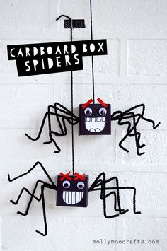 Cardboard Box Spiders... I must confess I am in love with these little guys!! the easiest and goofiest of halloween spiders made with pipe cleaners, googly eyes and paper | MollyMooCrafts.com