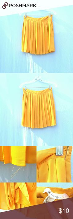 """FF21 Mustard Yellow pleated skirt small Gently worn mustard yellow pleated skirt. Has some strings fraying but does not bother with wear. The tag is also falling :( has a lining and a side zipper. No stains.  Tag Size : Small  Length : 17"""" Waist Flat lay : 13""""  #tothedunes yellow mustard pleased skater pleated skirt lining school girl 90s simple basic work chic modern work attire business casual fancy simple date night lunch summer spring trendy preppy casual bundle and save! Forever 21…"""
