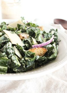 A healthy, crunchy kale Caesar salad with creamy homemade anchovy-fee Caesar dressing and homemade croutons. Via livelytable.com