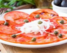 Carpaccio de tomates aux câpres pour brûler des calories : http://www.fourchette-et-bikini.fr/recettes/recettes-minceur/carpaccio-de-tomates-aux-capres-pour-bruler-des-calories.html