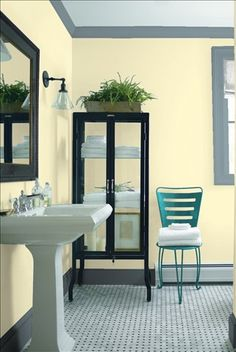 Look at the paint colour combination I created with Benjamin Moore. Via @benjamin_moore. Wall: Old Straw Hat 337; Trim: Water's Edge 1635; Chair: Teal Ocean 2049-30.
