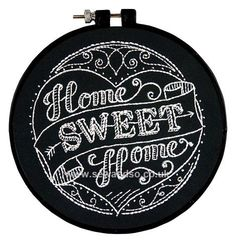 Love the look of the white embroidery on black fabric!  (Home Sweet Home Embroidery Kit from www.sewandso.co.uk)