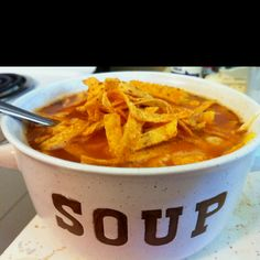 Best tortilla soup EVER! 2 cans of low sodium chicken broth 2 or 3 chicken breasts 2 cans of diced tomatoes, I like fire roasted for extra spice 1/2 onion 1 can of corn 1 can of black beans  1 can of diced green chilies 2 tsp cumin 2 tsp chili powder 1 tsp garlic powder  1 tsp butter  In one pan, boil the chicken breasts.  In another, add butter. Chop the onion as thick or fine as you like, and let them caramelize over the heat. Add the chicken broth, tomatoes, corn, black beans, green…
