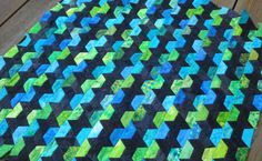 The most interesting half hexagon piecing I've even come across.  Love the colors too. Tutorial