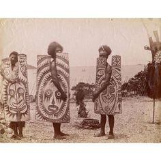 men with shields, papua new guinea
