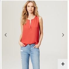 Mixed media shell A mixed media style is our idea of effortless allure. Split neck. Sleeveless. Banded trim at neckline and henley placket. Shirred beneath back neck. Hi-lo shirttail hem. CREAM COLOR**** LOFT Tops Blouses
