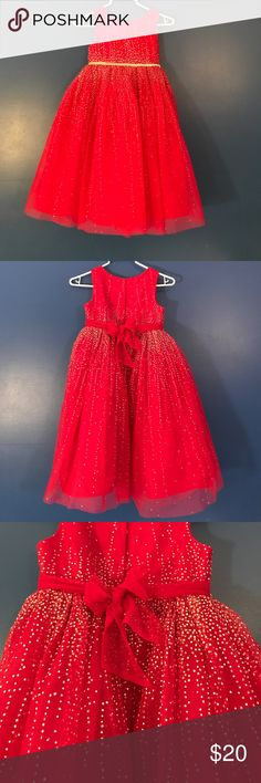 Girls red dress with silver sparkle Girls red dress. Silver sparkle accent front & back. Layered skirt with built in liner. Like new condition. Cherokee Dresses Formal