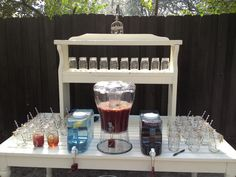 Outdoor bar with mason jars and sangria for an oyster roast