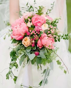 Hypericum berries brought an extra touch of grapefruit-pink to this trailing Fleurish bouquet of blooms and greenery. flowers pink The Prettiest Pink Wedding Bouquets Summer Wedding Bouquets, Flower Bouquet Wedding, Floral Wedding, Berry Wedding, Bridesmaid Bouquets, Coral Bridal Bouquets, Green Wedding, Elegant Wedding, Summer Wedding Centerpieces