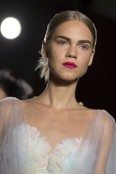 At Marchesa's spring/summer 2016 show during New York Fashion Week, a bright magenta lip, complemented gowns that were pastel-hued and soft in tone. (Photo: Carlo Allegri/Reuters)