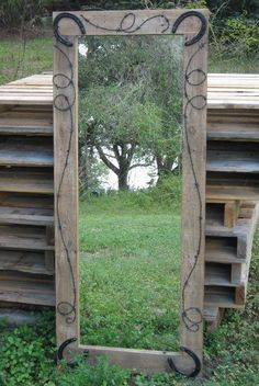Dollar store mirror, frame it with old barn wood, detail with barb wire, and old horse shoes