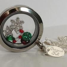 Candy cane, snowflake, star, and green stones in this Living Locket for your Holiday parties!
