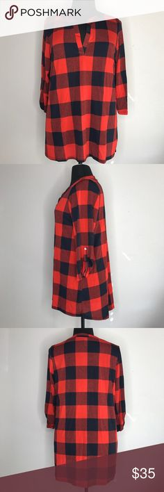 "Plus Size Plaid Tunic Love this top! Polyester & spandex give this a great feel. Great look for fall. Roll tab sleeves. Bust measurement 23""; length 31.5 mockingbird + poppy Tops Tunics"