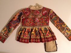 This is a child's dress from Gujarat, India.  It is a wrap around dress that looks to be about a size 3 to 5.  It is in perfect condition   with  ...   rugrabbit.com