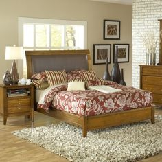 Set a warm tone in your master guest bedroom with this attractive pecan-finished sleigh bed. This beautiful bed is crafted of tropical mahogany wood and features an elegant upholstered padded headboard in a rich chocolate brown leatherette material.