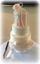 Bird cage, stencilling and sugar rose wedding cake