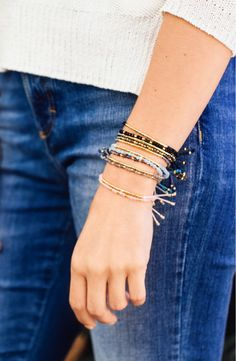 Strung with gorgeous semiprecious-stone beads, this set of two slender bracelets feature a glistening hammered-metal bar and glossy rondelles. A chic find from the NSale!